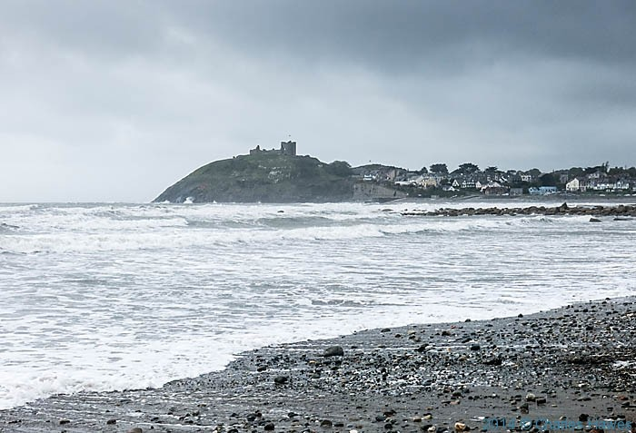 View to Criccieth castle from the beach, photographed from The Wales Coast Path by Charles Hawes