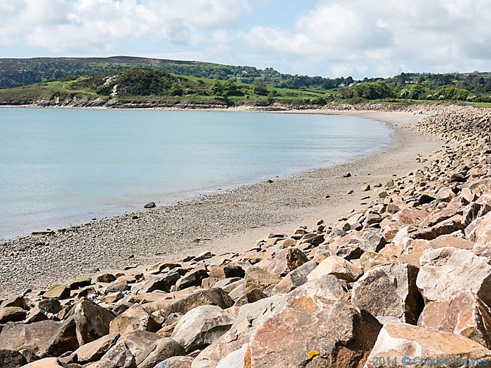 View to Carreg y Defaid from Traeth Crugan, photographed from The Wales Coast Path by Charles Hawes