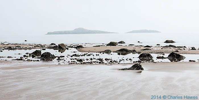View to Ynys Gwylan-fawr and Ynys Gwllan -bach photographed from Aberdarn beach by Charles Hawes