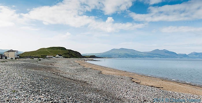 The beach and hill fort at Dinas Dinlle, photographed from the Wales Coast Path by Charles Hawes