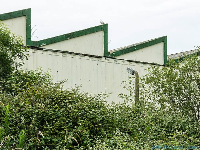 Redundant works adjacent to The Wales Coast path, photographed by Charles Hawes
