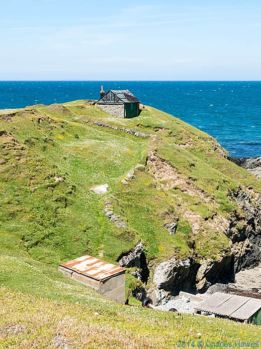 Herring smokery huts at Porth Ysgaden, photographed from The Wales Coast Path by Charles Hawes