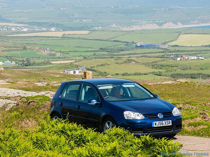 Car approaching Mynydd Mawr coastguard station, photographed from The Wales Coast Path by Charles Hawes
