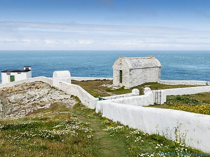 The magazine and old fog warning station at North Stack, Anglesey, photographed from The Coast Path by Charles Hawes