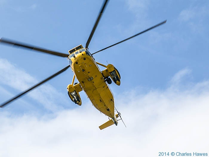 Search and Rescue helicopter over South Stack Cliffs, Anglesey, photographed from The Wales Coast Path by Charles Hawes