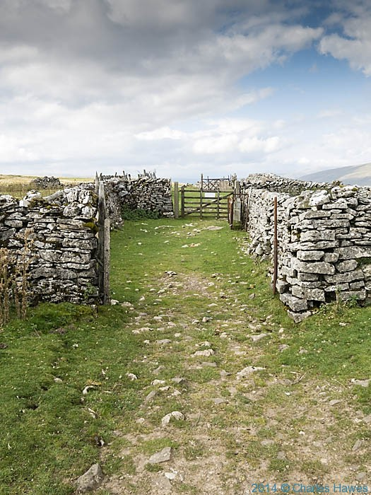 Sheep pens on the Cravan Way near Dent, photographed from The Dales High Way by Charles Hawes