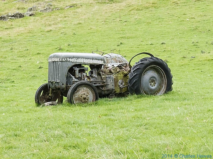 Tractor in field near Beezleys Farm, photographed by Charles Hawes