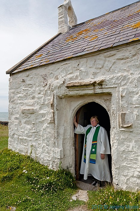 Rev. Madeleine BradyVicar of St Cwyfan's photographed by Jeremy Moore in Wales at The Water's Edge