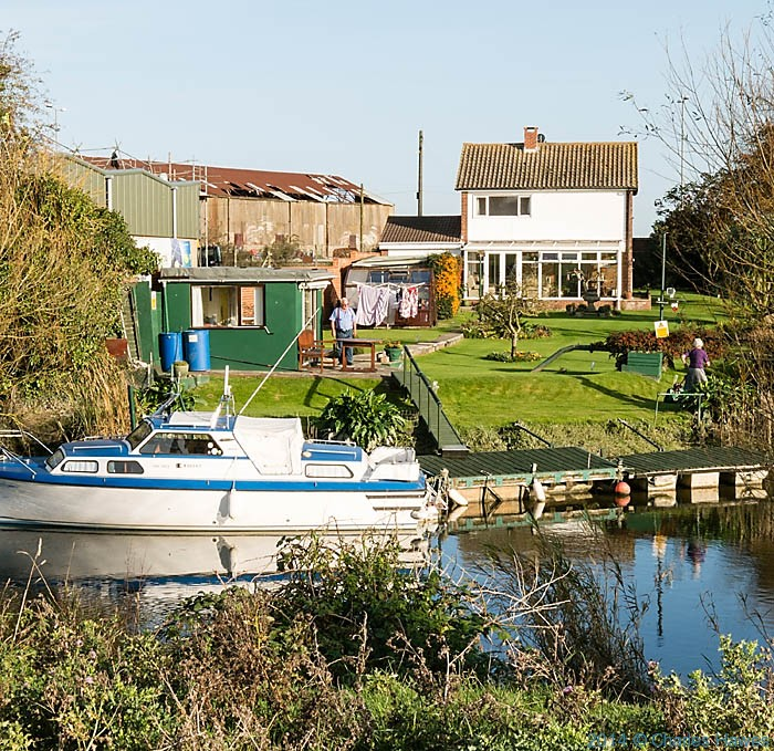 Prperty on the banks of the Stour in Sandwich, photographed from The Saxon Shore Way by Charles Hawes