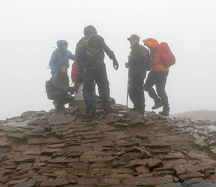 Group on summit of Pen-Y-Fan, Brecon Beacons National Park, Wales