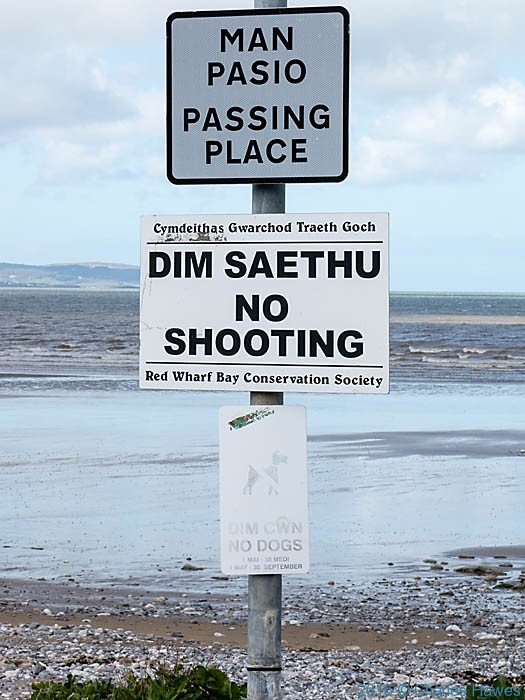 Sign at Llandonna beach, Anglesey, photographed from the Wales Coast Path by Charles Hawes