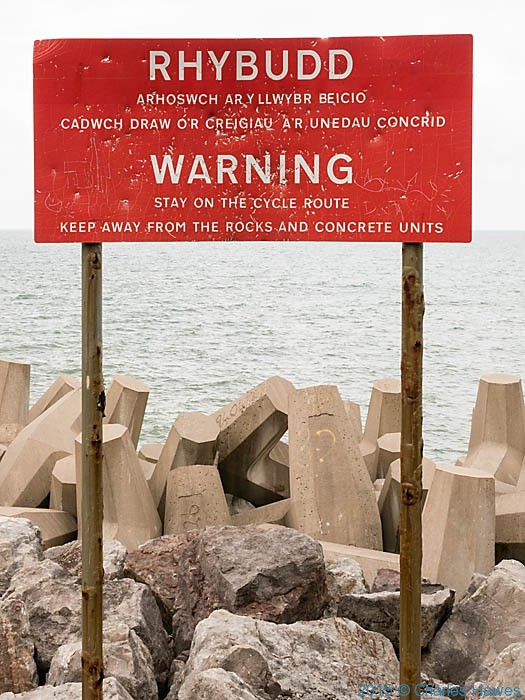 Warning sign on Penmaen Head, photographed from The Wales Coast Path by Charles Hawes