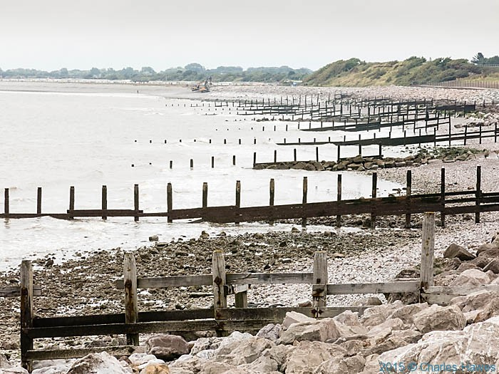Groynes near Llanddulas, photographed from The Wales Coast Path by Charles Hawes