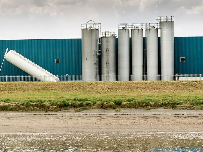 Industrial unit on the River Dee near Chester, photographed from The Wales Coast Path by Charles Hawes