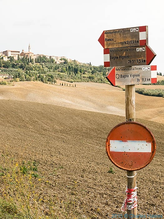 Waymark signs for public paths in countryside near Pienza, Tuscany, photographed by Charles Hawes