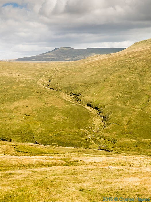 View to Corn Du and Pen Y Fan from Fan Dingarth, photographed on The Cambrian Way by Charles Hawes