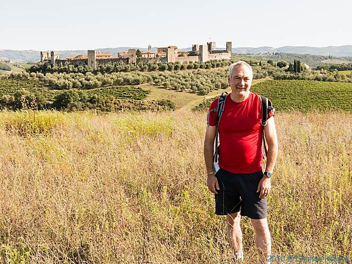 Charles Hawes on the Via Francigena near Monteriggioni, photographed from the Via Francigena