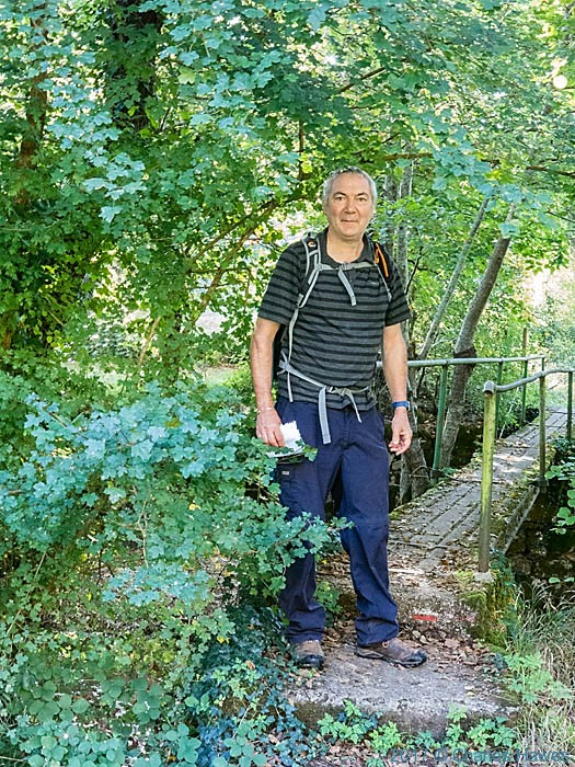 Charles Hawes on footbridge over the River Vere near Briniquel, France, photographed by Charles Hawes