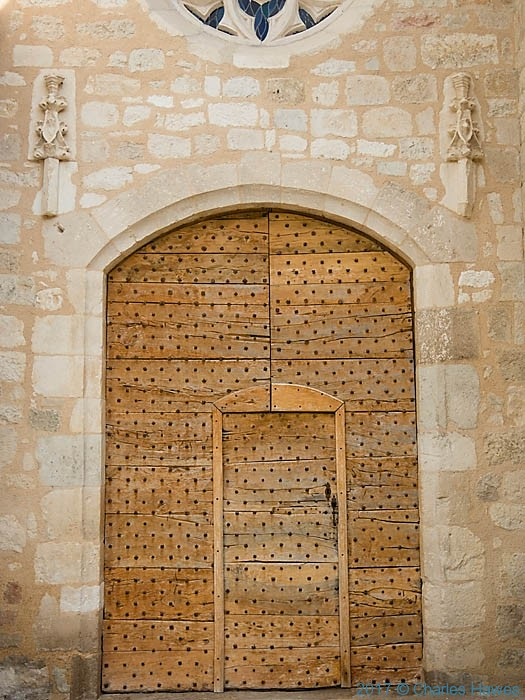 Door of the L'Eglise St Eugene in Vieux, France, photographed by Charles Hawes
