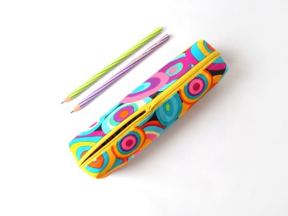 Pencil case with wonky circles in bright green, blue, yellow and purple