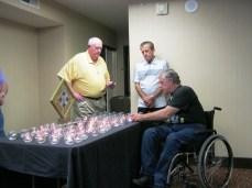 George Humphrey lighting a candle