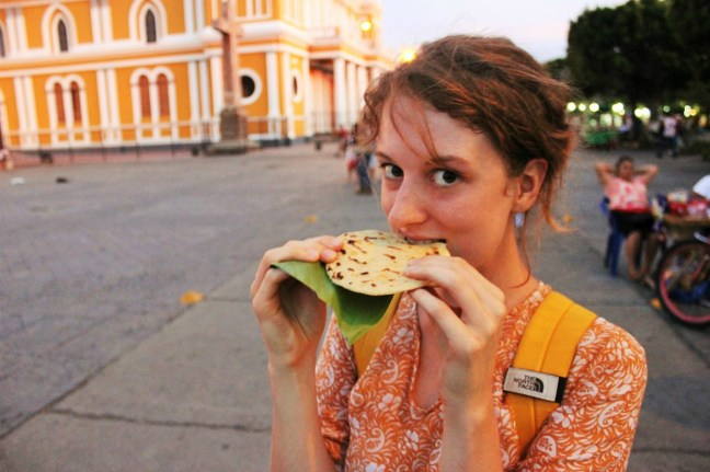 Me eating local delicious pupusa in Nicaragua