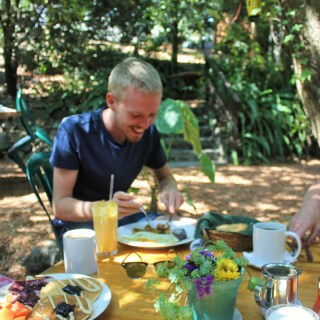 Eating pancakes at Valhalla Macadamia Nut Farm