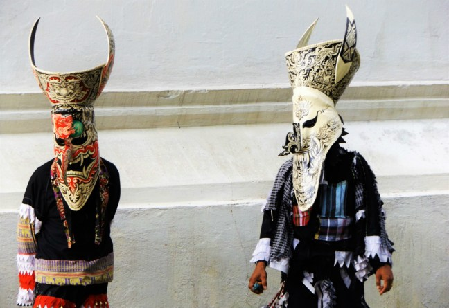 In their Masks at Phi Ta Khon Festival Thailand - Loei - Charlie on Travel