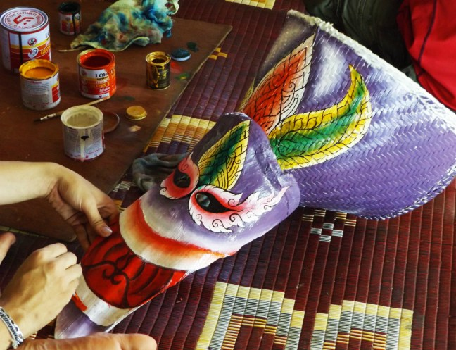 Painting mask at Phi Ta Khon Festival Thailand