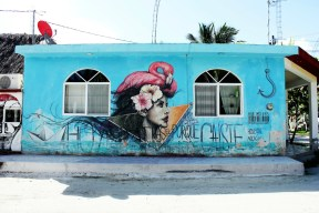 Woman flamingo mural - Isla Holbox Mexico - Charlie on Travel