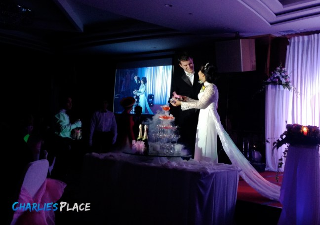 Cutting a fake wedding cake before we even eat anything
