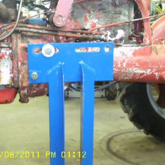 Here the stand is attached to the torque tube of a Farmall Cub that is in the process of being restored.