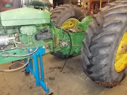 This is the heavy duty stand splitting a John Deere 4630 tractor for transmission repair.