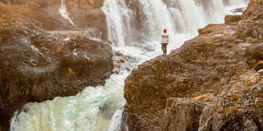 Girl in red hat hanging out at Kolugljúfur Canyon