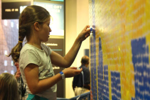 collaborative sticker wall at 2016 Charlotte Mini Maker Faire