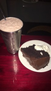 My 11:30 pm diner of a milkshake and cake after flying. It was vegan cake so I can pretend it's healthy