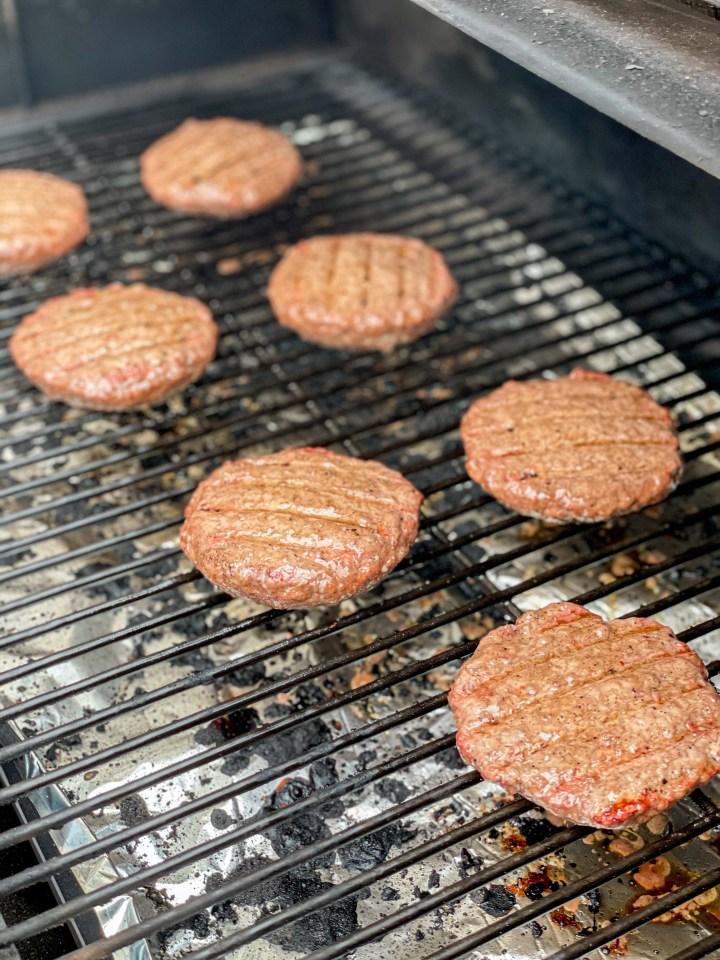 Jalapeno Popper Stuffed Burgers on the smoker