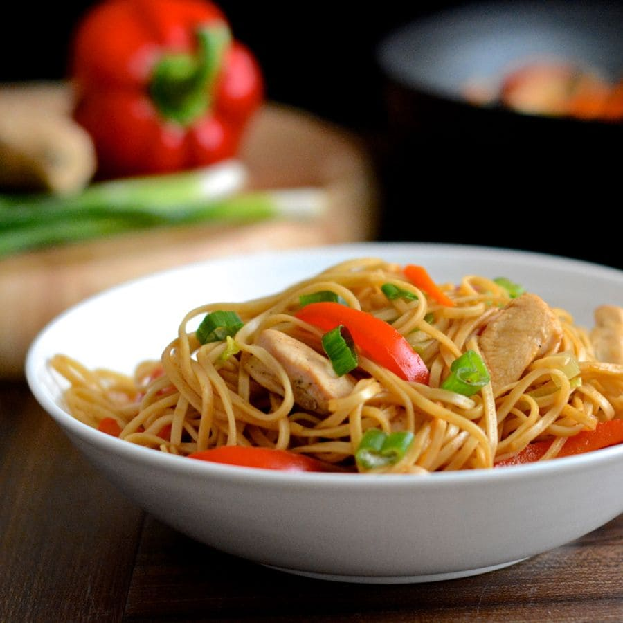 Chicken chow mein charlottes lively kitchen a bowl of homemade chicken chow mein with a wok and chopping board of ingredients in forumfinder Images