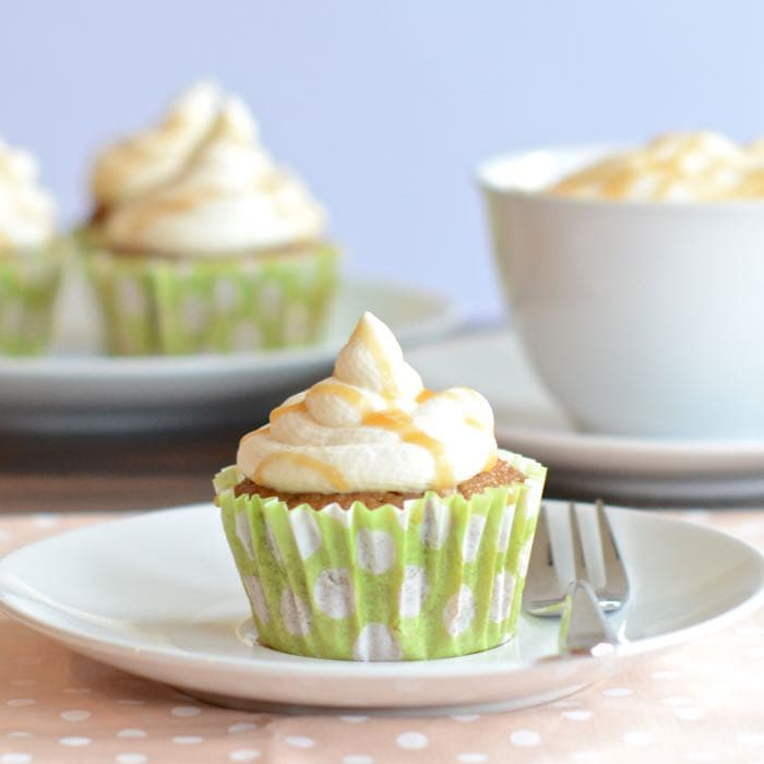 Caramel Macchiato Cupcakes - Delicious coffee sponge with a hidden caramel centre, topped with whipped vanilla cream and drizzled with a bit more caramel.
