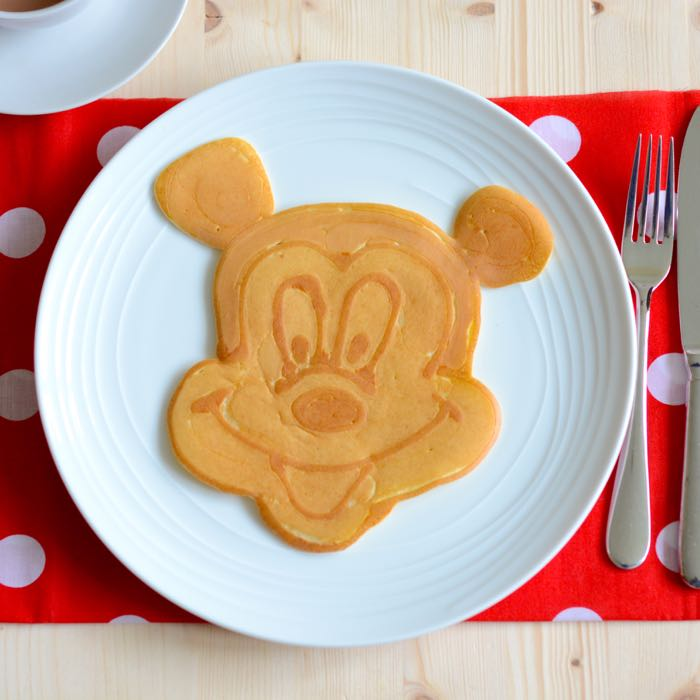 How to make a mickey mouse pancake charlottes lively kitchen mickey mouse pancake art ccuart Gallery