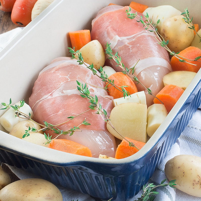 A complete roast dinner with only 10 minutes of preparation, ready in under an hour and using just one tray (so hardly any washing up). Chicken wrapped in parma ham with potatoes, parsnips, carrots, peas and even the gravy!