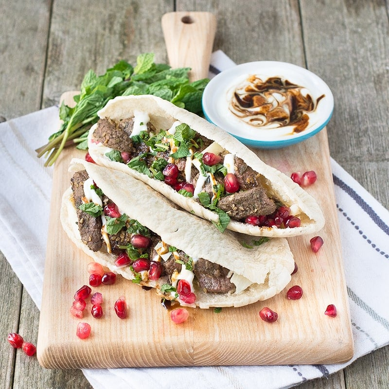 Za'atar lamb pittas with pomegranate and mint, ready in just 5 minutes, the perfect quick and tasty lunch.