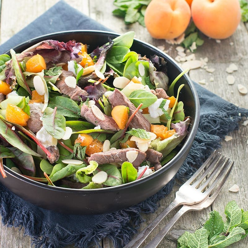 Liven up your lunch with this delicious lamb salad with flaked almonds, apricots and goats cheese. Perfect for a healthy lunch or summer barbecue.