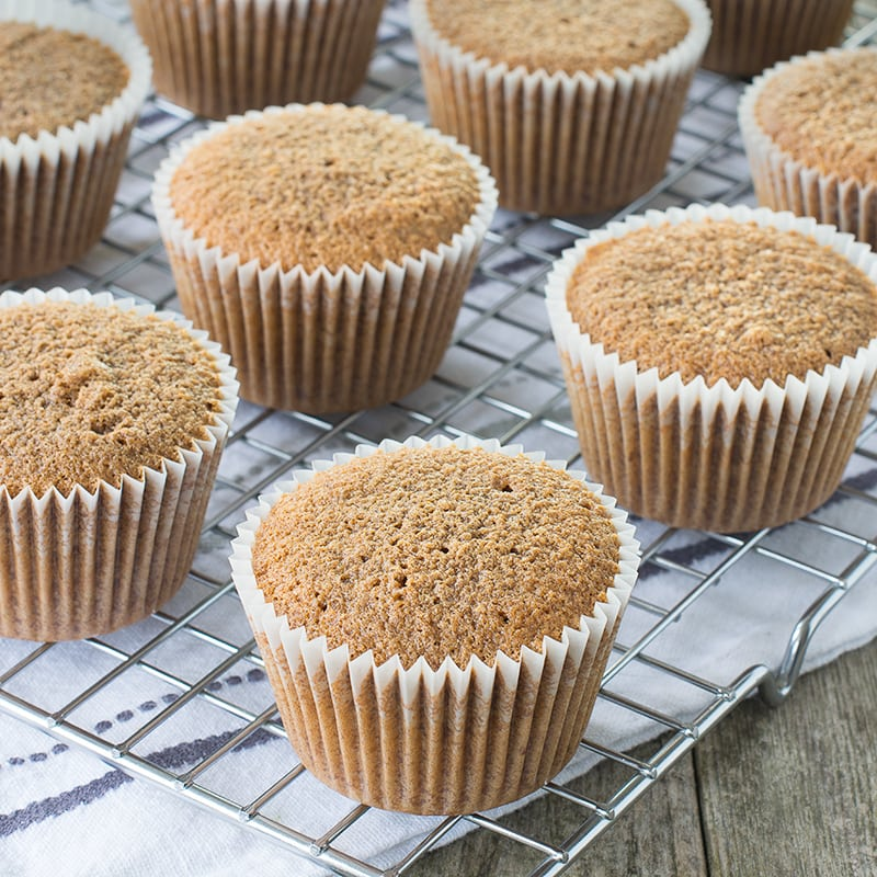 Freshly baked coffee cupcakes on a cooling rack.