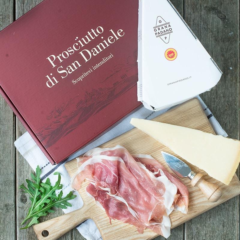 Prosciutto di San Daniele and Grana Padano cheese with their packaging.