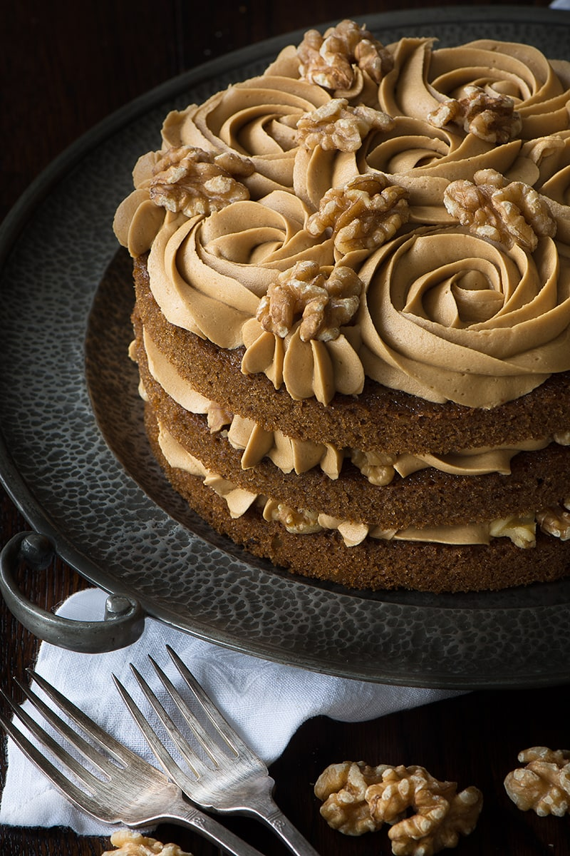 My recipe for a classic Coffee & Walnut Cake. Three layers of delicious coffee sponge packed full of chopped walnuts and topped with smooth coffee buttercream.