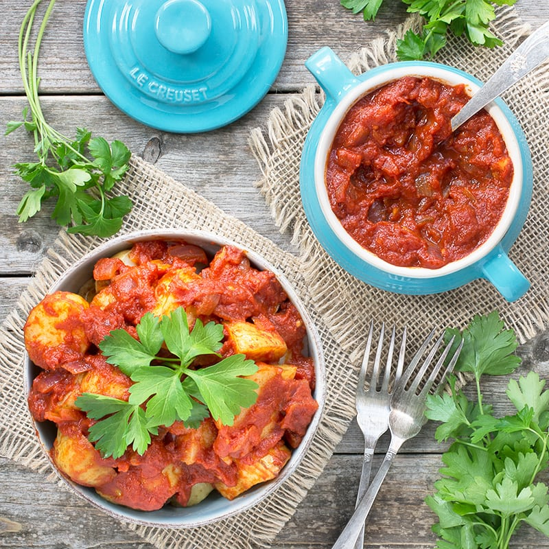 Delicious garlic roasted potatoes in a rich tomato sauce flavoured with smoked paprika.
