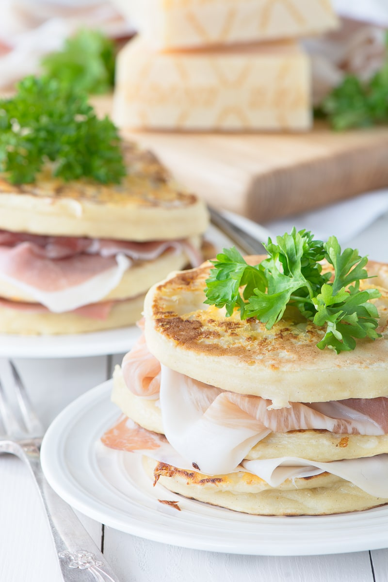 Two stacks of Grana Padano pancakes layered with Prosciutto di San Daniele.