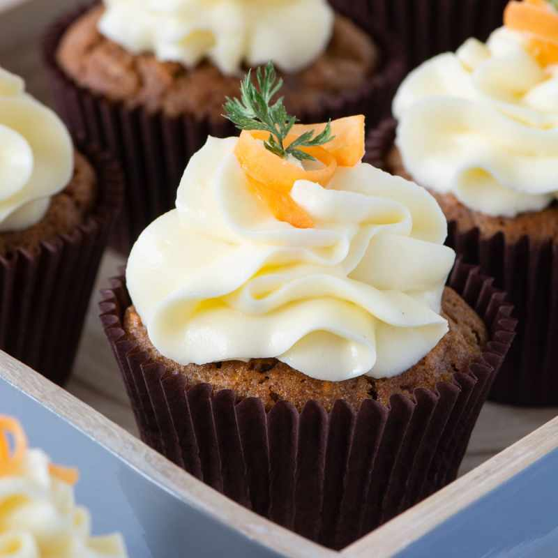 Carrot Cake Cupcakes - Delicious spiced carrot cake cupcakes topped with smooth cream cheese buttercream.