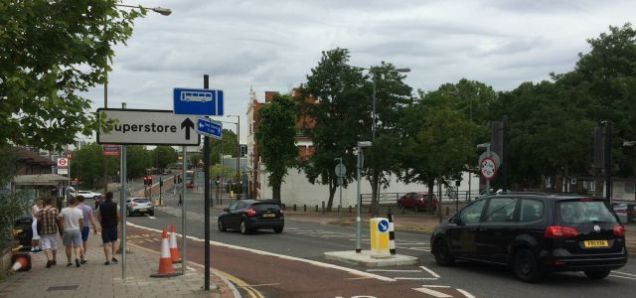 A huge motorway-size sign adds to street clutter at Charlton Church Lane